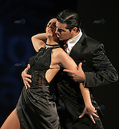 The Argentine couple of Yanina Silvina Ferro (L) and Eric Adolfo Kahl dance during the semifinal round of the Stage Tango competition at the Tango Dance World Championship in Buenos Aires on August 25, 2012.   AFP PHOTO / Alejandro PAGNI