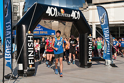 © Licensed to London News Pictures. 05/10/2016. Bristol, UK. Marathon runner BEN SMITH at the start of his final 401st marathon, in Millennium Square in Bristol harbour side. Ben has been undertaking a 'World Record' attempt which will see him have run 401 marathons in 401 consecutive days around 309 different locations of the UK mainland. The challenge aims to raise both awareness of the issues of bullying in society along with £250,000 for two charities dedicated to tackling bullying, 'Stonewall' and 'Kidscape'. Both these charities work to support award winning initiatives which against bullying in UK schools and society in all its forms. Photo credit : Simon Chapman/LNP