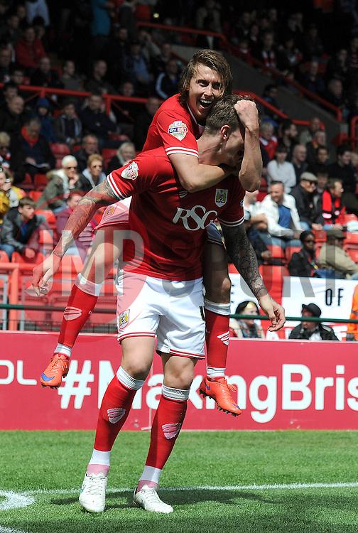 Bristol City's Aden Flint celebrates his goal with Bristol City's Jay Emmanuel-Thomas - Photo mandatory by-line: Dougie Allward/JMP - Mobile: 07966 386802 - 03/05/2015 - SPORT - Football - Bristol - Ashton Gate - Bristol City v Walsall - Sky Bet League One