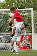 May 12, 2012; Huntsville, AL, USA;  Oak Mountain's David DePriest (9) goes for the ball over Auburn's Blake Boldt (12). Mandatory Credit: Marvin Gentry