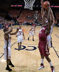 Florida State Seminoles forward Al Thornton (12) has a shot blocked by Virginia Cavaliers forward Jason Cain (33).  The Virginia Cavaliers Men's Basketball Team defeated the Florida State Seminoles 73-70 at the John Paul Jones Arena in Charlottesville, VA on February 17, 2007.