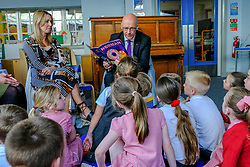 Pictured: Teacher Lisa Black and John Swinney take the lead in story telling and singing songs<br />