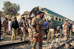 KARACHI, Nov. 3, 2016 (Xinhua) -- Pakistani soldiers stand guard at a train accident site in southern Pakistani port city of Karachi on Nov. 3, 2016. At least 21 people were killed and 45 others injured when two passenger trains collided with each other in Pakistan's southern port city of Karachi on Thursday morning, hospital officials said. (Xinhua/Masroor) (sxk) (Credit Image: © Masroor/Xinhua via ZUMA Wire)