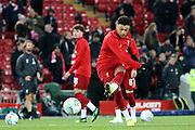 Liverpool midfielder Alex Oxlade-Chamberlain (15) warming up during the EFL Cup match between Liverpool and Arsenal at Anfield, Liverpool, England on 30 October 2019.