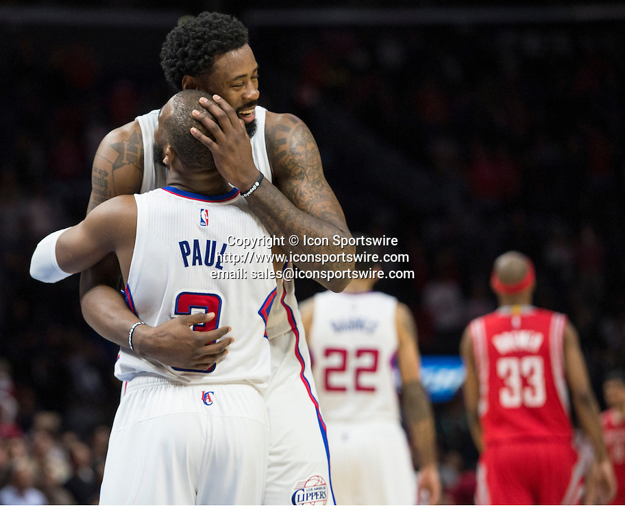 Feb. 11, 2015 - Los Angeles, CA, USA - Los Angeles Clippers' DeAndre Jordan celebrates with teammate Chris Paul after defeating the Houston Rockets at Staples Center in Los Angeles on Wednesday. Clippers win with the score of 110 to 95.