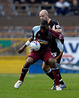 Photo: Jed Wee.<br />Burnley v Hull. Coca Cola Championship. 14/10/2006.<br /><br />Burnley's Gifton Noel-Williams (L) holds off Hull's Danny Mills.