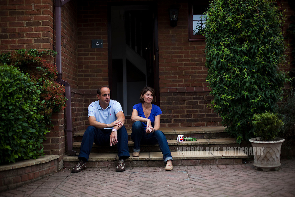 Julio and Eva Vildosola sit on the steps of their new home, on September 1, 2012, in Buckden, England. The Spanish family immigrated to England due to the ongoing economic crisis that has impacted heavily on Spain. (Photo by Warrick Page)