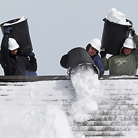 (Westwood, MA - 2/24/15) Workers clear snow from a roof, Tuesday, February 24, 2015. Staff photo by Angela Rowlings.
