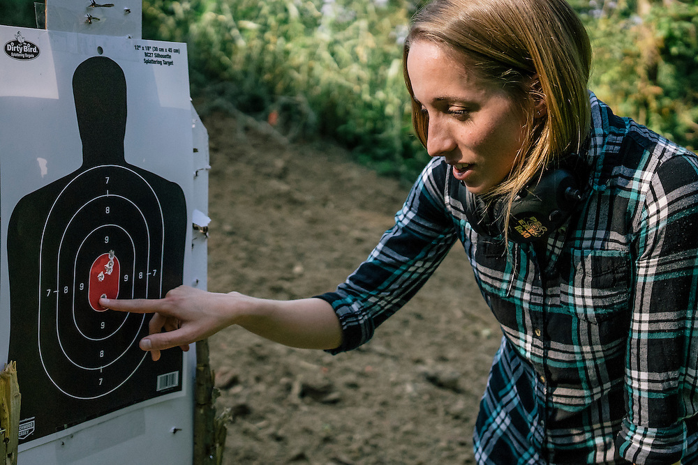 Security researcher Runa Sandvik inspects the targets after using a hack on the Tracking Point TP750 rifle. The hack can control the trajectory of the bullets fired.
