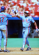 ST. LOUIS - UNDATED:  Tim Raines of the Montreal Expos celebrates with teammates during an MLB game versus the St. Louis Cardinals at Busch Stadium in St. Louis, Missouri.  Raines played for the Expos from 1979-1990. (Photo by Ron Vesely)  Subject:  Tim Raines