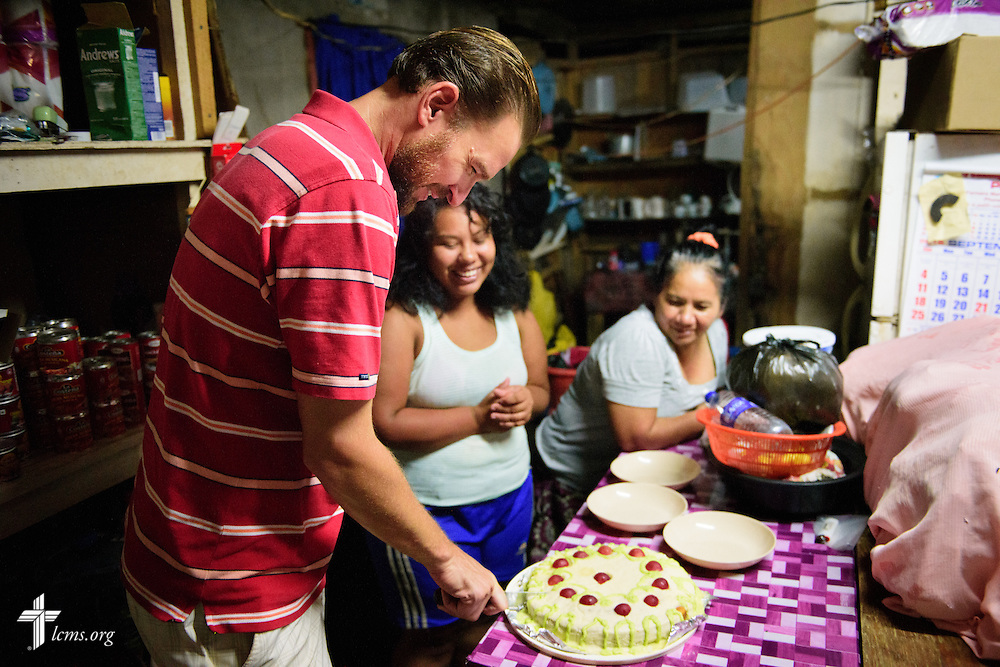 The Rev. Duane Meissner, career missionary to Belize, cuts a cake as he shares in fellowship following an invitation on Wednesday evening, Sept. 28, 2016, in Seine Bight, Belize.  LCMS Communications/Erik M. Lunsford