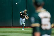 Oakland Athletics right fielder Chad Pinder (18) throws the ball to the infield against the Los Angeles Angels at Oakland Coliseum in Oakland, California, on September 6, 2017. (Stan Olszewski/Special to S.F. Examiner)