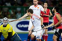 RAIPUR (India) .  Constantijn Jonker (Ned) heeft gescoord en op de achtergrond Mirco Pruijser (Ned)  tijdens de kwartfinale tussen  de mannen van Nederland en Canada  in het  Hockey World League Finale toernooi .  Keeper Antoni Kindler (l) is verslagen.   ANP KOEN SUYK