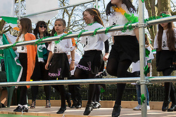 London, March 13th 2016. The annual St Patrick's Day Parade takes place in the Capital with various groups from the Irish community as well as contingents from other ethnicities taking part in a procession from Green Park to Trafalgar Square.  PICTURED: Girls dance on the back of a truck. ©Paul Davey<br /> FOR LICENCING CONTACT: Paul Davey +44 (0) 7966 016 296 paul@pauldaveycreative.co.uk