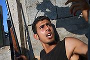 Rebels in the frontline in the area of Gorji in Tripoli near Bab Al Azizia the Qaddafi compound.