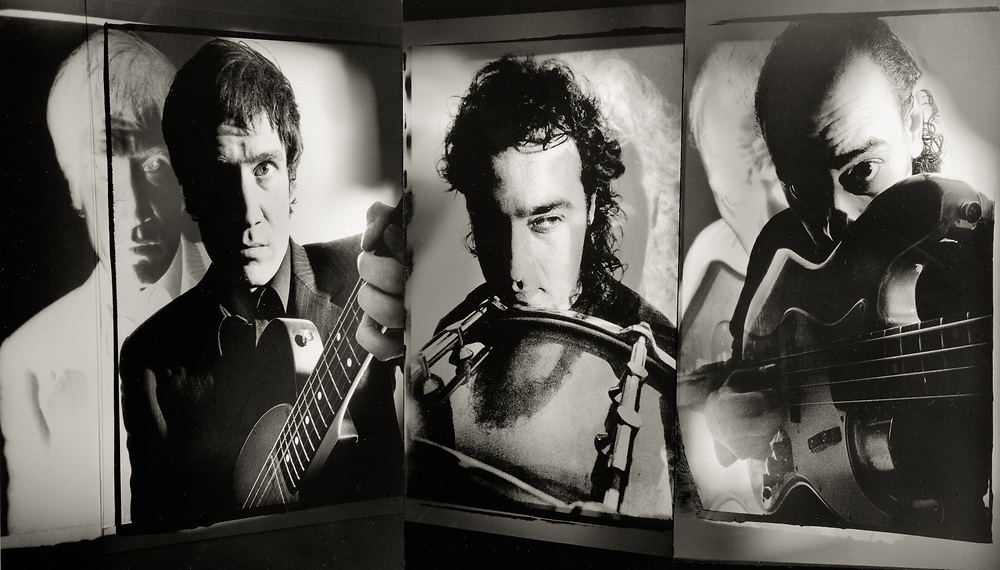 Wilko Johnson, guitarist and song writer with Dr Feelgood, Solid Senders and Wilko Johnson Band, drummer Salvatore Romundo and Norman Watt Roy, bass player with Ian Dury and the Blockheads photographed at a Kings Cross studio in 1992.