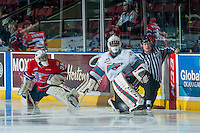 KELOWNA, CANADA - FEBRUARY 27: Lasse Petersen #35 of Spokane Chiefs and Michael Herringer #30 of Kelowna Rockets stretch on the ice during warm up on February 27, 2016 at Prospera Place in Kelowna, British Columbia, Canada.  (Photo by Marissa Baecker/Shoot the Breeze)  *** Local Caption *** Lasse Petersen; Michael Herringer;