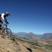 Nicolas Walser, Switzerland, in action during the New Zealand South Island Downhill Cup Mountain Bike series held on The Remarkables face with a stunning backdrop of the Wakatipu Basin. 150 riders took part in the two day event. Queenstown, Otago, New Zealand. 9th January 2012. Photo Tim Clayton