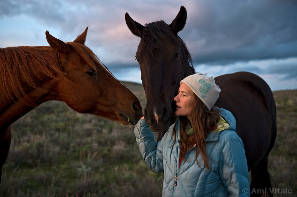 Horses gather around Danielle Lattuga in the summer pastures of the Centennial Valley of Southwestern Montana in June 2012.  Spurred by growing consumer concern over meat's environmental impact and concerned about the long-term viability of their livelihood, a cohort of ranchers is trying to apply the understanding gleaned from the science of ecology to livestock management.