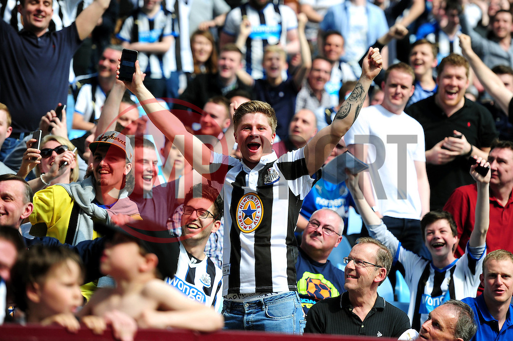 Newcastle United fans celebrate as news travels through the away end that Chelsea are beating relegation rivals Sunderland  - Mandatory by-line: Dougie Allward/JMP - 07/05/2016 - FOOTBALL - Villa Park - Birmingham, England - Aston Villa v Newcastle United - Barclays Premier League