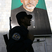 07 October 2004&#xD;&#xA;Kabul, Afghanistan.&#xD;&#xA;Election preparations in Afghanistan.&#xD;&#xA;&#xD;&#xA;A painting of Hamid Karzai, Afghanistans interim President and contender in this weekends election, looks down from a building in centeral Kabul. With fears of violent dissruption worrying candidates and voters alike Afghanistans security forces are becoming more and more visible on the streets of the capital.&#xD;&#xA;<br />