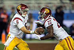 SANTA CLARA, CA - DECEMBER 05:  Quarterback Cody Kessler #6 of the USC Trojans hands off to running back Justin Davis #22 during the second quarter of the Pac-12 Championship game at Levi's Stadium on December 5, 2015 in Santa Clara, California. The Stanford Cardinal defeated the USC Trojans 41-22. (Photo by Jason O. Watson/Getty Images) *** Local Caption *** Cody Kessler; Justin Davis