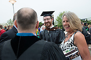 Glen Pepe (Center) is congratulated by family and friends for receiving his MFA in Theater. Photo by Ben Siegel