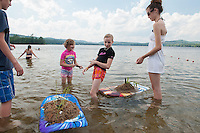 Jack Williams, Emma and Mabray Neill and Allie Williams built boogie board sand castles as they enjoyed a perfect summer's day at Waukewan Beach Friday afternoon.  (Karen Bobotas/for the Laconia Daily Sun)