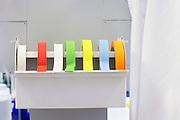 Rolls of multi-coloured labelling tape in laboratory