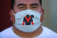 HOT SPRINGS, AR - MAY 02:  Groomer wears a mask in the paddock area during the Covid-19 Pandemic on Derby Day at Oaklawn Racing Casino Resort on May 2, 2020 in Hot Springs, Arkansas. (Photo by Wesley Hitt/Getty Images)