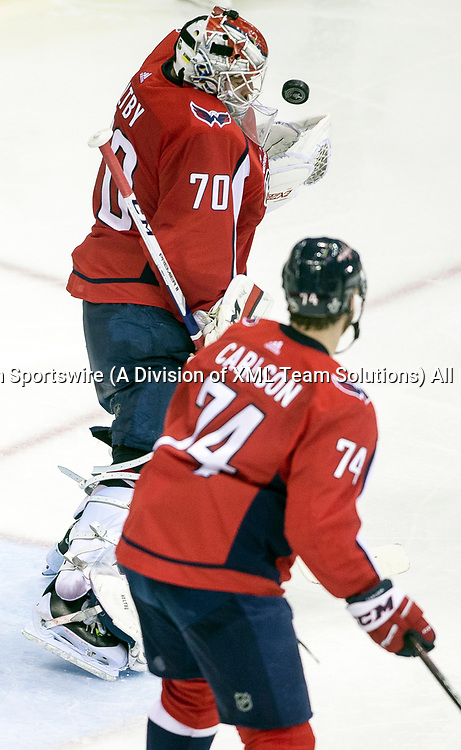 WASHINGTON, DC - MAY 21: Washington Capitals goaltender Braden Holtby (70) makes a standup save in the second period during game 6 of the NHL Eastern Conference  Finals between the Washington Capitals and the Tampa Bay Lightning, on May 21, 2018, at Capital One Arena, in Washington D.C.<br /> (Photo by Tony Quinn/Icon Sportswire)