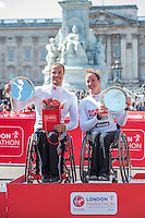 Tatyana McFadden of the USA, winner of the Women's Wheelchair race and Marcel Hug of Switzerland, winner of the Men's wheelchair race on the podium at the Virgin Money London Marathon 2014 at the finish line on Sunday 13 April 2014<br /> Photo: Dillon Bryden/Virgin Money London Marathon<br /> media@london-marathon.co.uk