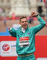 Michael Roeger AUS celebrates on the podium after winning the T46 Men World Para Athletics Marathon Championships. The Virgin Money London Marathon, 28 April 2019.<br /> <br /> Photo: Joe Toth for Virgin Money London Marathon<br /> <br /> For further information: media@londonmarathonevents.co.uk