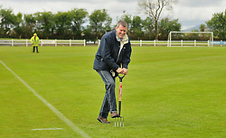 Tom Jennings groundsman Milebush Castlebar get surface water of the pitch during the Connaught Cup final between Castlebar Celtic and Ballinasloe Town.<br /> Pic Conor McKeown