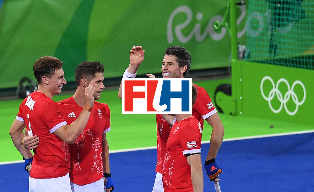 Britain's Harry Martin (L) celebrates scoring a goal during the men's field hockey Brazil vs Britain match of the Rio 2016 Olympics Games at the Olympic Hockey Centre in Rio de Janeiro on August, 9 2016. / AFP / MANAN VATSYAYANA        (Photo credit should read MANAN VATSYAYANA/AFP/Getty Images)