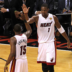 Jun 19, 2012; Miami, FL, USA; Miami Heat point guard Mario Chalmers (15) high fives power forward Chris Bosh (1) during the third quarter in game four in the 2012 NBA Finals against the Oklahoma City Thunder at the American Airlines Arena. Mandatory Credit: Derick E. Hingle-US PRESSWIRE