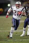 PITTSBURGH - JANUARY 23:  Running back Corey Dillon #28 of the New England Patriots scores on a 25 yard touchdown run in the third quarter against the Pittsburgh Steelers during the AFC Championship game at Heinz Field on January 23, 2005 in Pittsburgh, Pennsylvania. The Pats defeated the Steelers 41-27. ©Paul Anthony Spinelli  *** Local Caption *** Corey Dillon