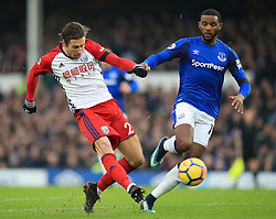 West Bromwich Albion's Grzegorz Krychowiak (left) and Everton's Cuco Martina battle for the ball during the Premier League match at Goodison Park, Liverpool.