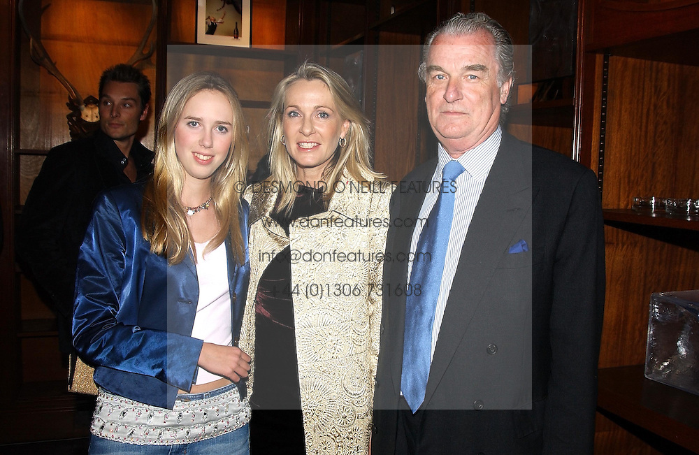 Left to right, the HON.DAISY BELL and her parents LORD & LADY BELL at a party hosted by jeweller Theo Fennell and Dominique Heriard Dubreuil of Remy Martin fine Champagne Cognac entitles 'Hot Ice' held at 35 Belgrave Square, London, W1 on 26th October 2004.<br /><br />NON EXCLUSIVE - WORLD RIGHTS