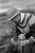 A man cutting peat on a stretch of land on the island of Lewis in the Outer Hebrides, Scotland. Peat cutting was a traditional method of gathering fuel for the winter in the sparsely-populated areas on Scotland's west coast and islands. The peat was dried and used in fires and ovens.