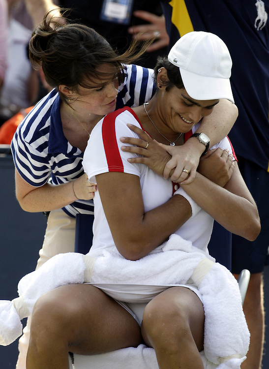 Eleni Daniilidou of Greece receives treatment from a trainer as she plays Alona Bandarenko of Ukraine during their second round match on the third day of the 2007 US Open tennis tournament in Flushing Meadows, New York, USA, 29 August 2007.