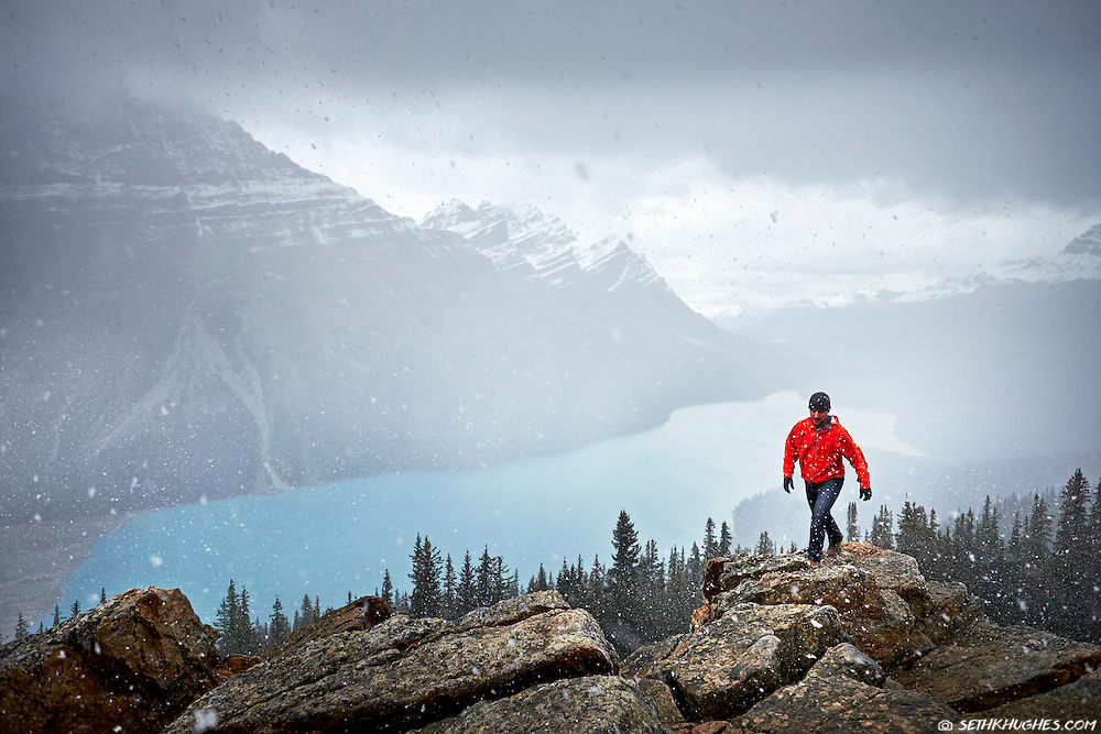 Hiking in the snow at high elevation above Peyto Lake in Banff National Park, Alberta, Canada.