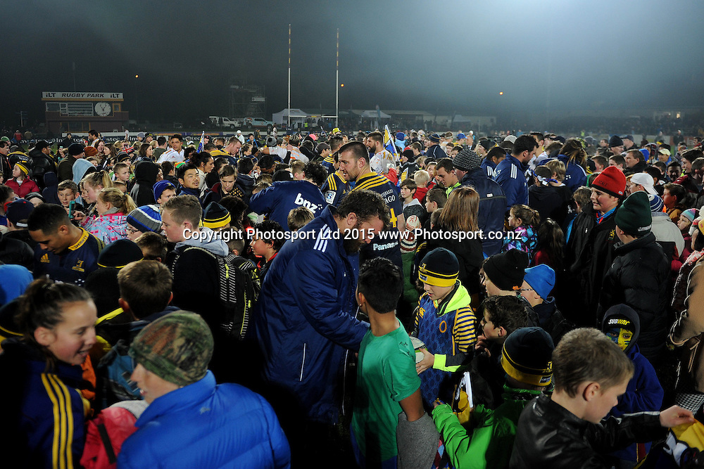 The crowd flood the field, following the Super Rugby Match between the Highlanders and the Chiefs, held at Rugby Park, Invercargill, New Zealand, 30th May 2015. Credit: Joe Allison / www.Photosport.co.nz