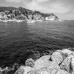 Catalina Island Casino with Avalon Harbor and breakwall rocks black and white photo. Beautiful Santa Catalina Island is a popular travel destination off the Southern California coast. Photo is high resolution. Copyright ⓒ 2017 Paul Velgos with All Rights Reserved.