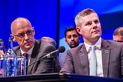 Pictured: Deputy First Minister John Swinney and Finance Cabinet Secretary Derek Mackay paid close attention to the words of the First Minister<br /> The members of the SNP gathered in the Scottish Events Centre in Glasgow for their annual conference.<br /> <br /> Ger Harley | EEm 10 October 2017