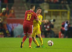 BRUSSELS, BELGIUM - Sunday, November 16, 2014: Wales' Joe Allen and Belgium's Eden Hazard during the UEFA Euro 2016 Qualifying Group B game at the King Baudouin [Heysel] Stadium. (Pic by David Rawcliffe/Propaganda)