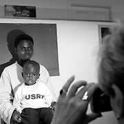 Bernadetta Mukeshimana gets her ID photo taken for her Social Security by a International Rescue Committee case worker after their arrival from a refugee camp to be settled in Phoenix, Arizona.