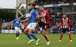 George Boyd of Peterborough United in action with Jason Shackell of Lincoln City - Mandatory by-line: Joe Dent/JMP - 12/10/2019 - FOOTBALL - Weston Homes Stadium - Peterborough, England - Peterborough United v Lincoln City - Sky Bet League One
