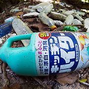 Garbage on one of Palau's Rock Islands. The item in the foreground is a bottle of bleach from Japan, underscoring the point that garbage knows no boundaries