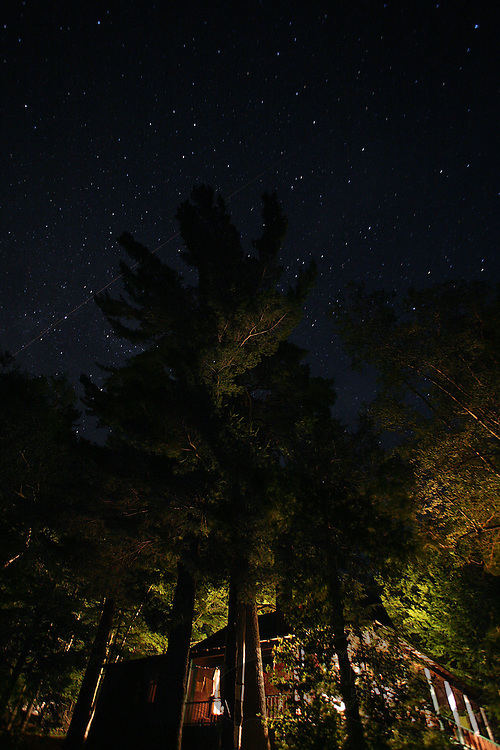 Stars show in the night sky over Tupper Lake in Adirondack Park near the town of Tupper Lake, New York.  Photo by Gary Cosby Jr.